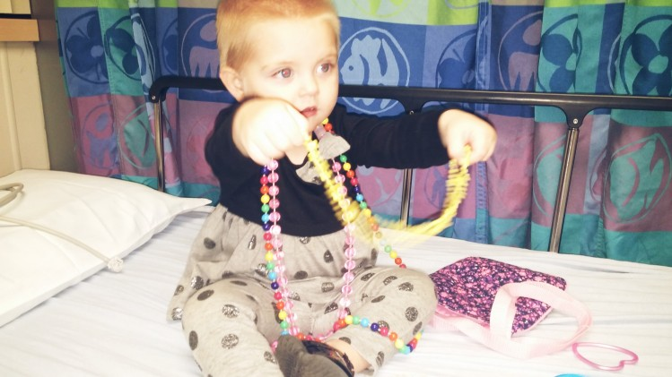 Lucy Jo and her beads at the hospital.